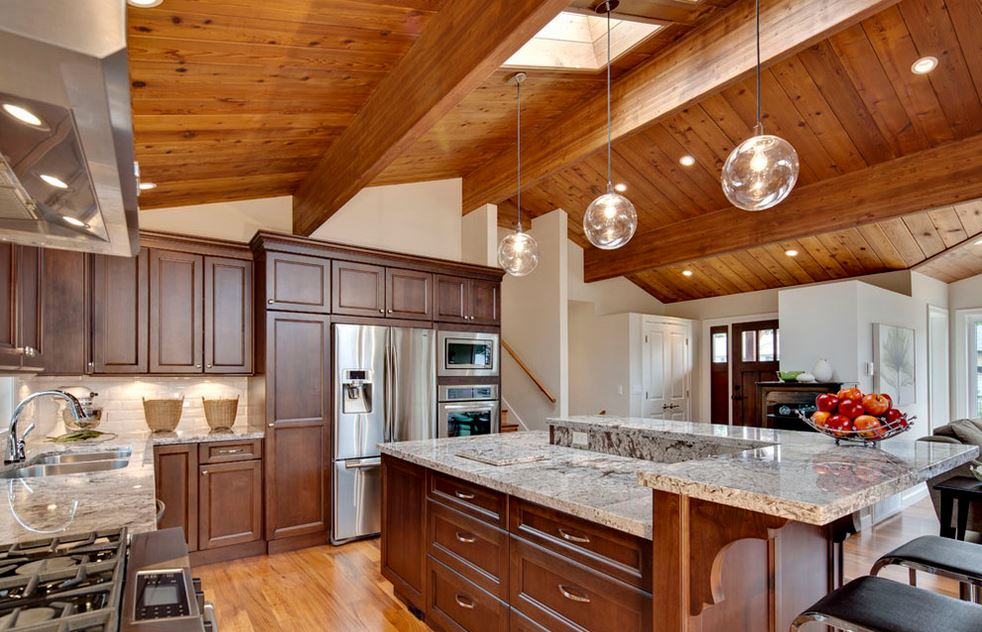 A Modern Kitchen With Wooden Ceilings